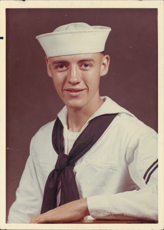 Photo of young man in US Navy uniform.